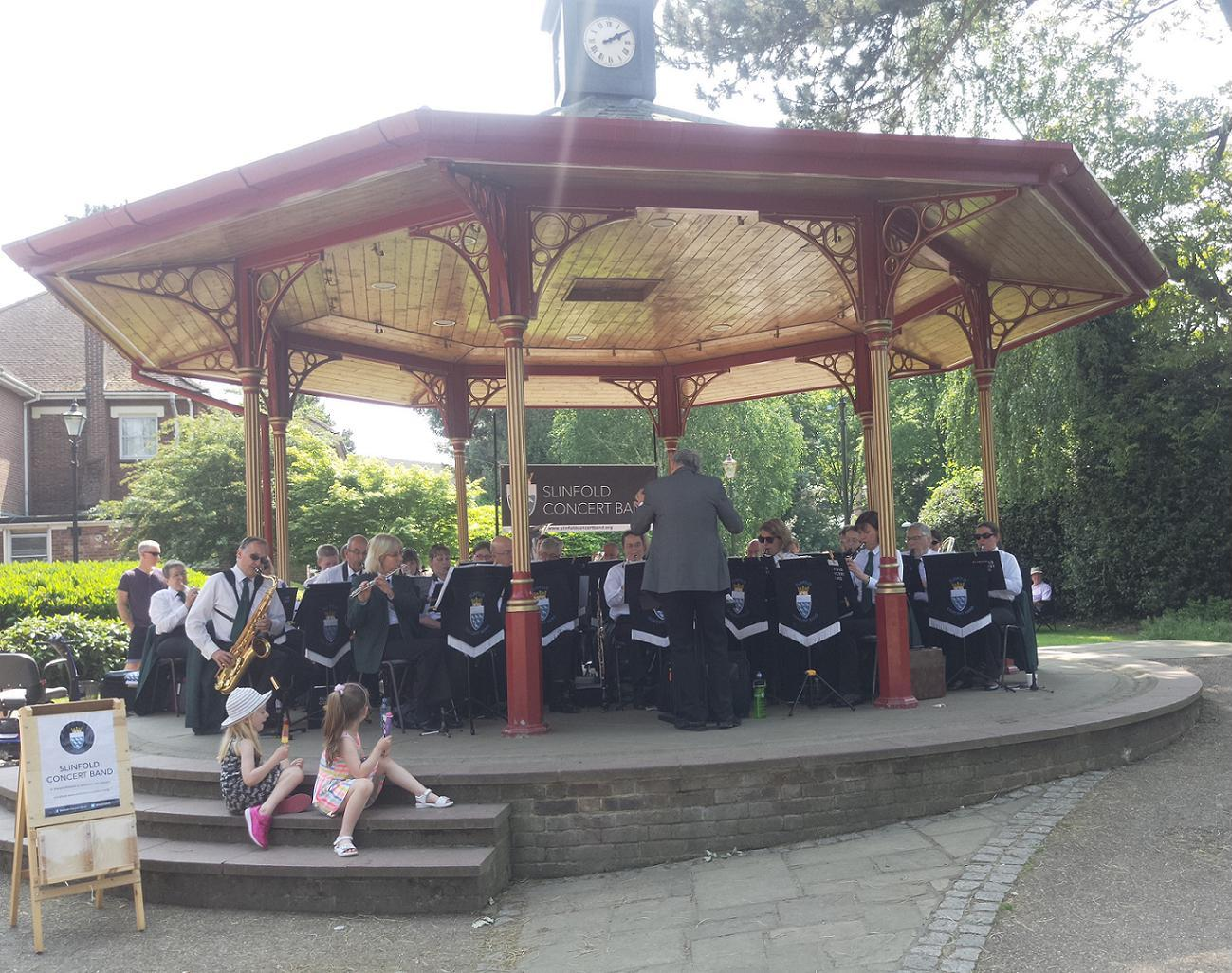 Slinfold Concert Band performing on the bandstand in Horsham Park